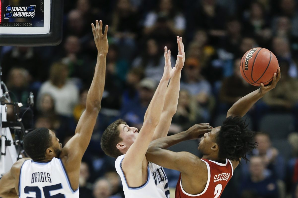 Villanova guard/forward Mikal Bridges and guard Collin Gillespie defend Alabama guard Collin Sexton during the first-half in the second-round of the NCAA men´s basketball tournament on Saturday, March 17, 2018 at PPG Paints Arena in Pittsburgh.