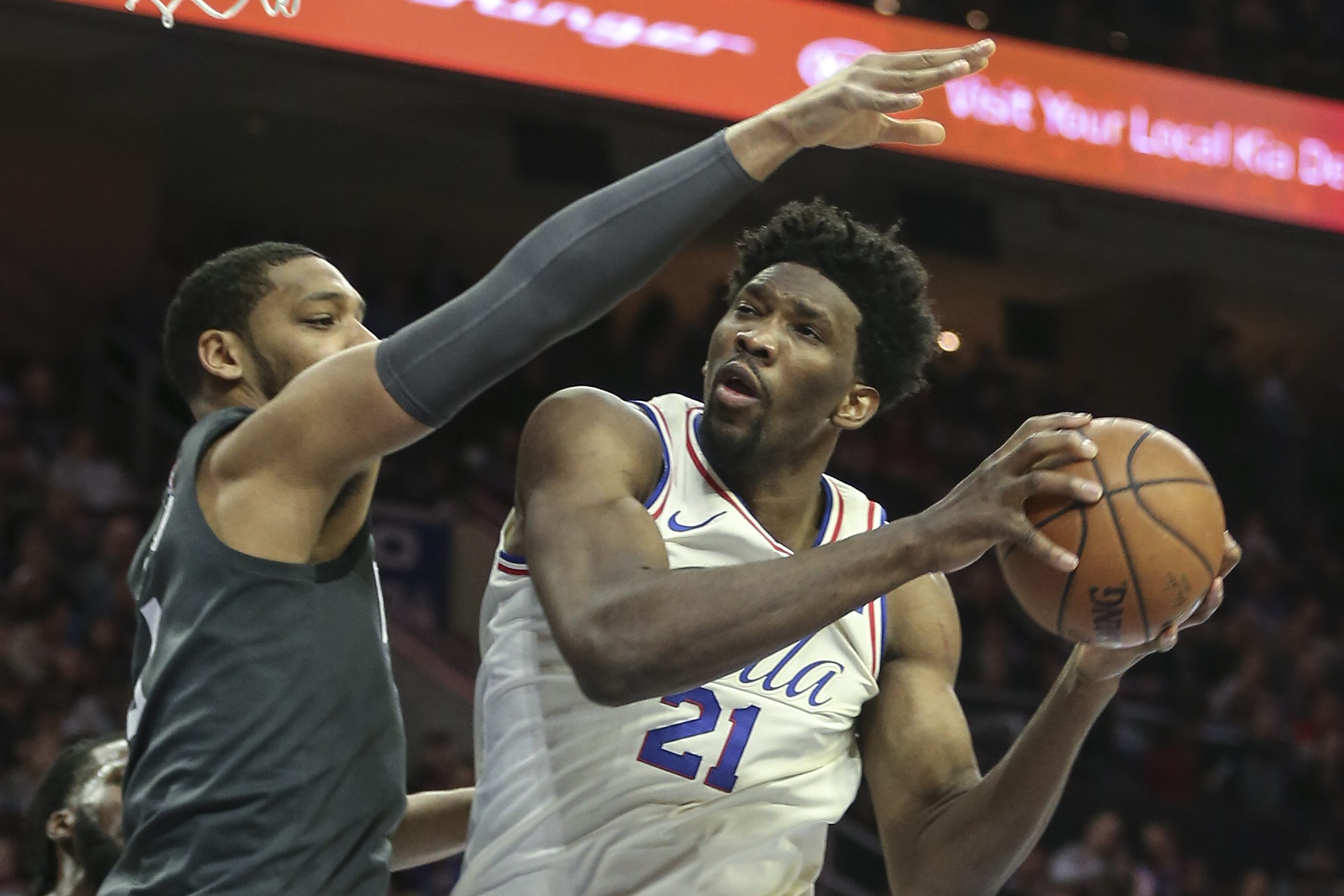 Sixers´ center Joel Embiid goes up against former Sixer and current Nets big man Jahlil Okafor during the Sixers´ win on Friday.