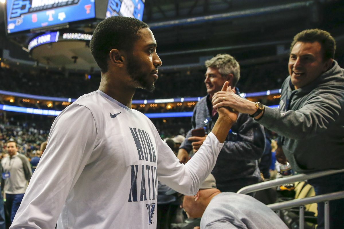 Villanova guard/forward Mikal Bridges celebrates Villanova's second-round NCAA men's basketball tournament win over Alabama with fans on Saturday, March 17, 2018 at PPG Paints Arena in Pittsburgh.