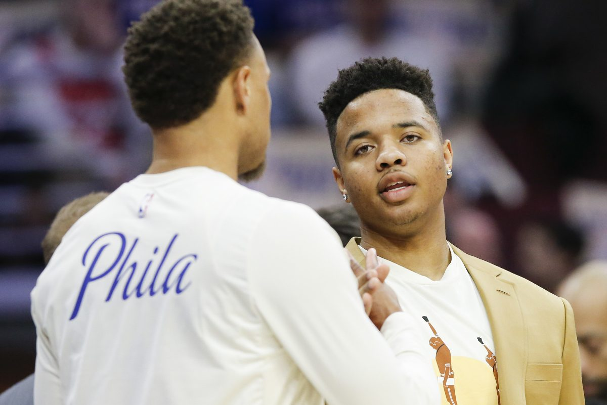 Sixers guard Markelle Fultz (right) talking to teammate Justin Anderson during a game in early February.