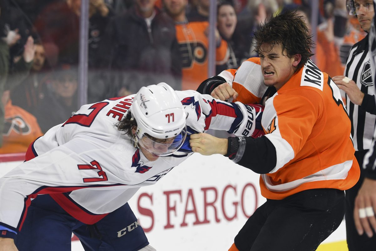 Travis Konecny and Washington's T.J. Oshie slug it out in the third period of the Flyers' 6-3 win Sunday.