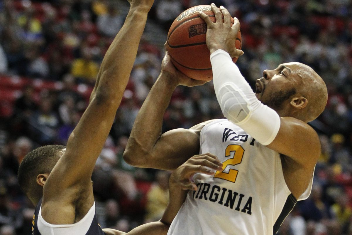 West Virginia is led by senior guard Jevon Carter (right).