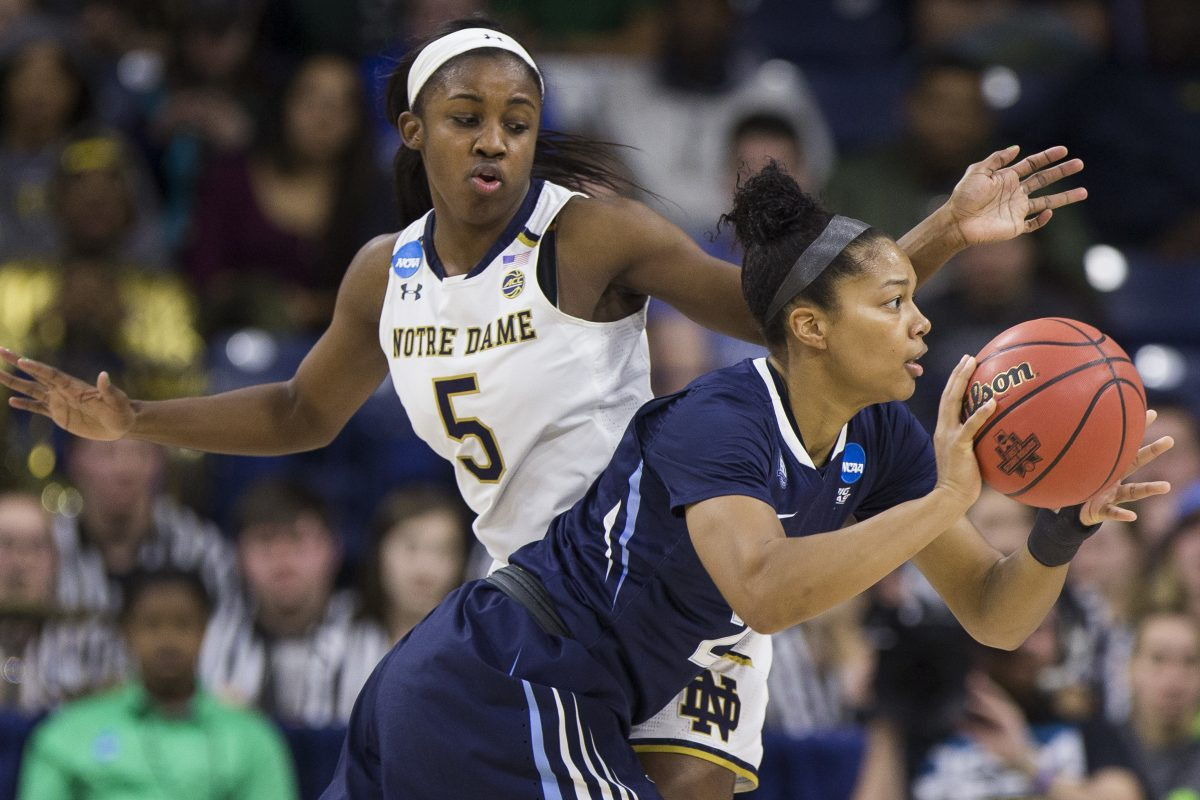 Villanova's Jannah Tucker, front, passes the ball around Notre Dame's Jackie Young (5) during a second-round game in the NCAA women's college basketball tournament Sunday, March 18, 2018, in South Bend, Ind. Notre Dame won 98-72.