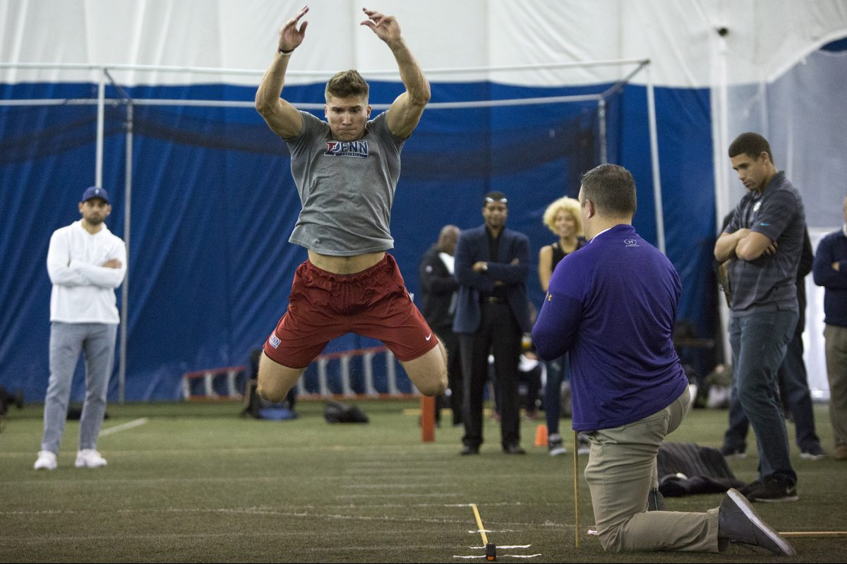 Inside UPenn's Dunning-Cohen Champions' Field, Wide Receiver Justin Watson does his long jump for the NFL's Pro day. March 19th, Philadelphia.