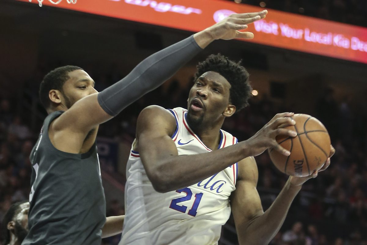 Joel Embiid (right) still doesn't participate in every workout.