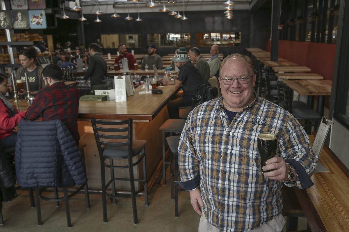 Tom Kehoe, co-owner and founder of the Yards Brewing Co., lifts a pint in the taproom of the brewery's massive new Spring Garden location.