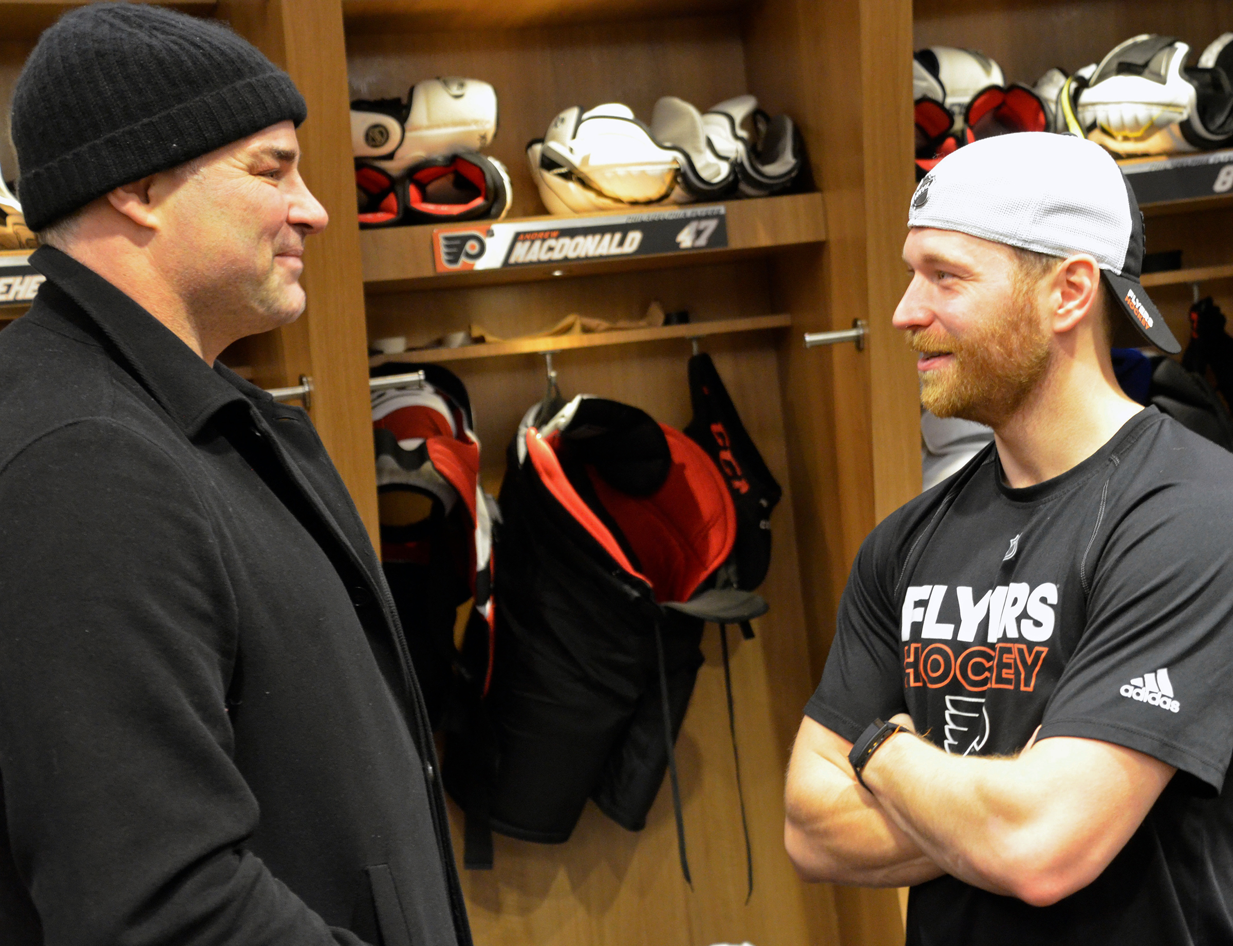 Former Flyer Eric Lindros (left) chats with current Flyer Claude Giroux.
