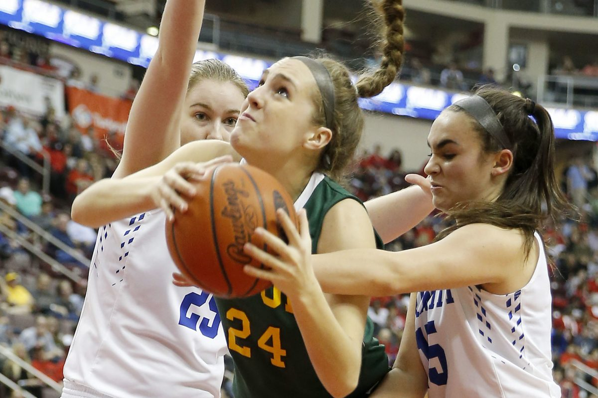 Archbishop Wood High´s Katie May drives to the basket against Trinity High´s Alayna Cappelli (right) and Rachel Lemons (left) during the PIAA 5A girl´s basketball championship game on Saturday, March 25, 2017 at the Giant Center in Hershey, PA. YONG KIM / Staff Photographer.