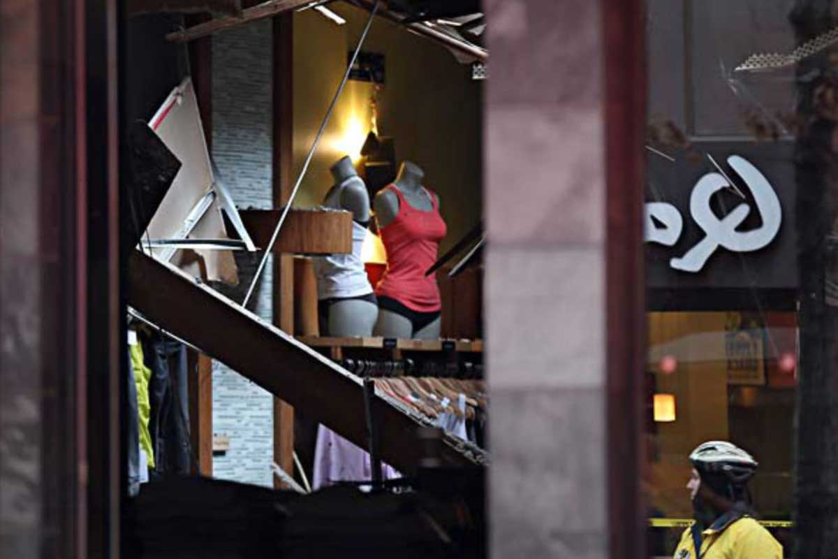 A piece of the ceiling hangs down inside the Lululemon Athletica store after a piece of a neighboring wall came crashing through on Jan. 27, 2015. Falling bricks injured shopper Allison Friedman.