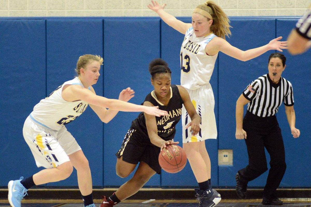 Neumann-Goretti´s Diamond Johnson #5 steals the ball away from St. Basil´s Casey Remolde #23 and Cheryl Remolde #13 St. Basil´s in the second quarter of a PIAA Class 3A girls basketball playoff Friday, March 16, 2018 at Bensalem High School in Bensalem, Pennsylvania. WILLIAM THOMAS CAIN/For The Inquirer