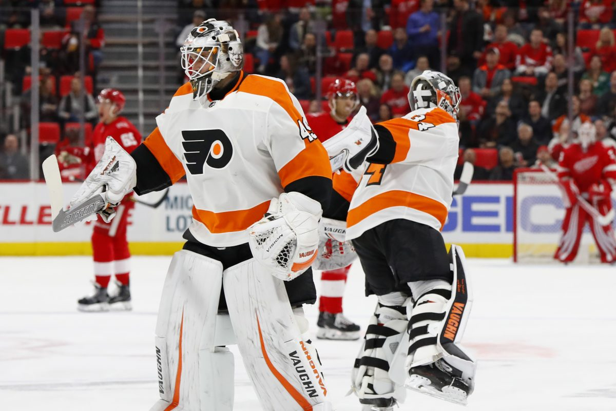 Flyers goaltender Alex Lyon (left) replaces the struggling Petr Mrazek during the second period of Tuesday's game in Detroit.