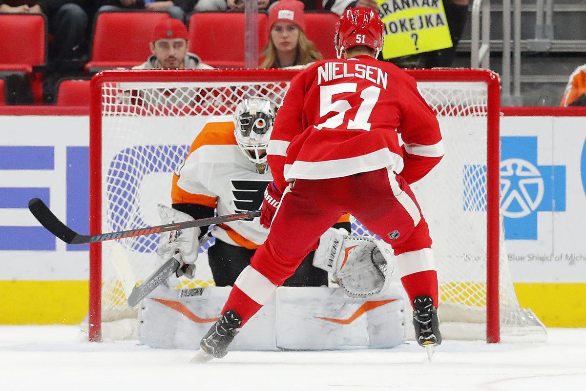 Detroit Red Wings center Frans Nielsen scores the only goal of the shootout on Flyers goaltender Alex Lyon.