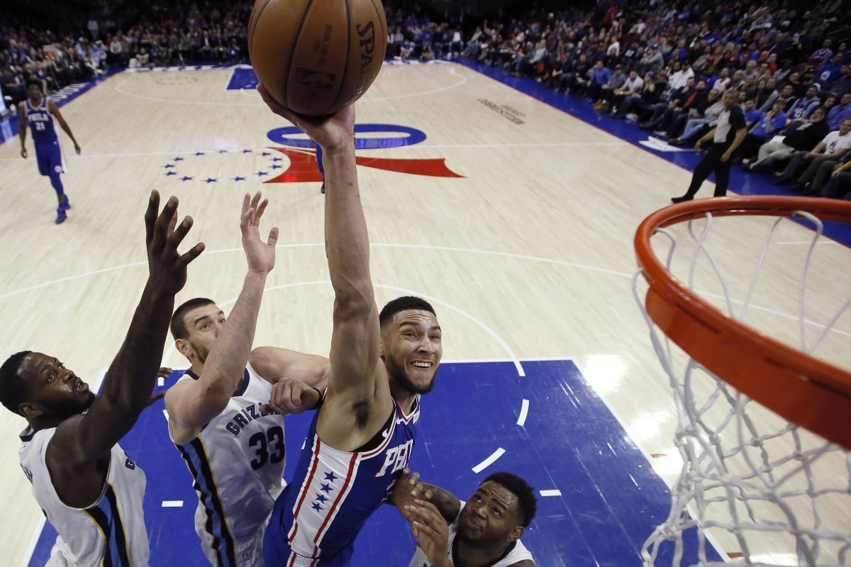 The Sixers' Ben Simmons, goes up for a shot against the Memphis Grizzlies' JaMychal Green, Marc Gasol and Jarell Martin, from left, during the first half Wednesday night.