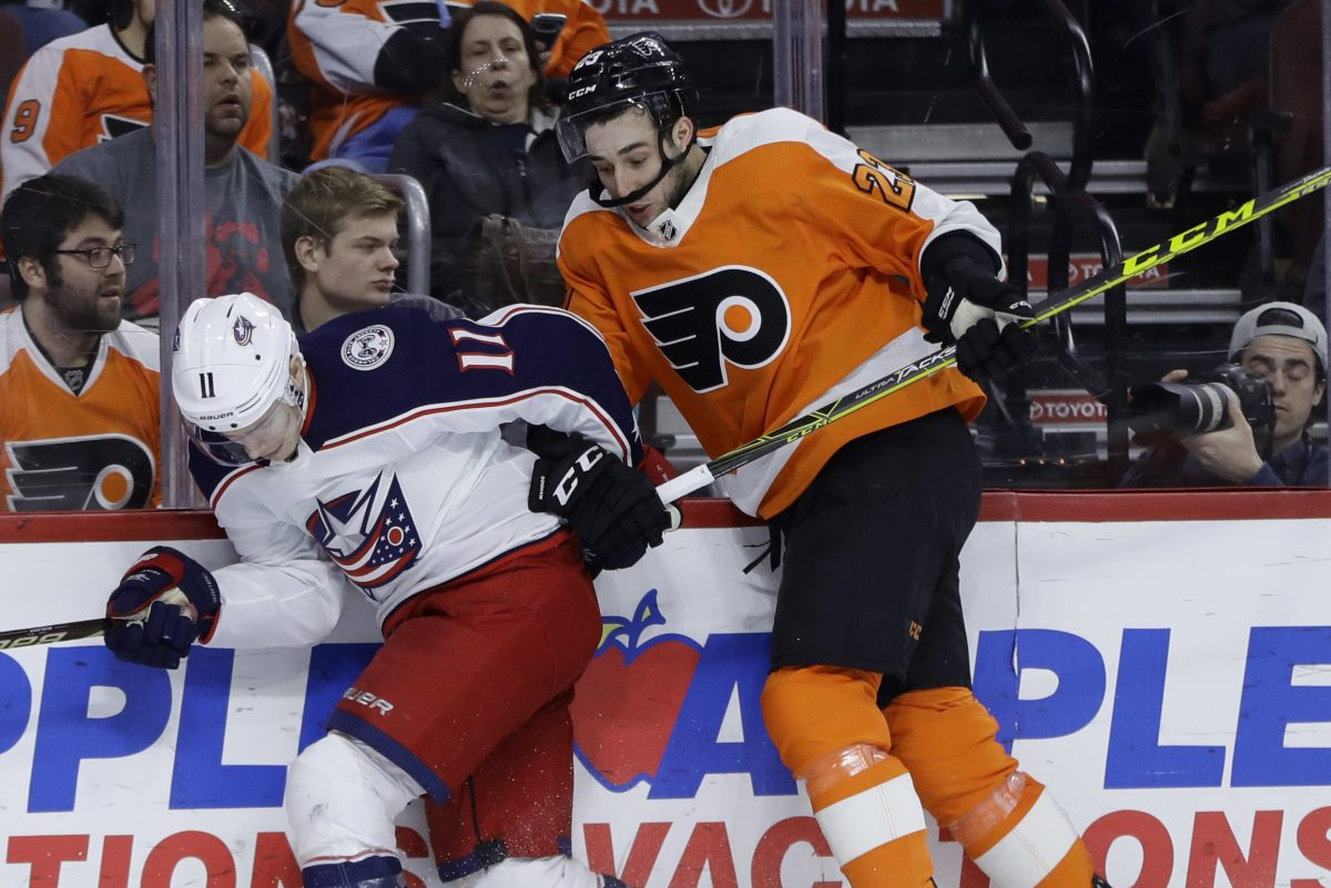 Columbus' Matt Calvert, left, and the Flyers' Brandon Manning collide during the third period of a recent game. Manning will return to the lineup Thursday after a two-game benching.