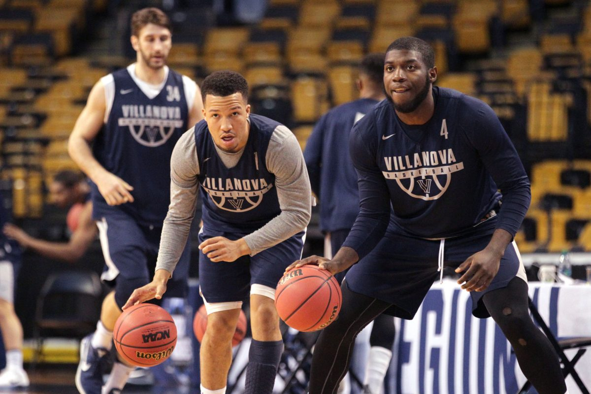 Jalen Brunson, center, of Villanova and Eric Paschall, right, during their practice session in TD Garden on March 22, 2018.  They will face West Virginia in the round of 16 in the NCAA Tournament.
