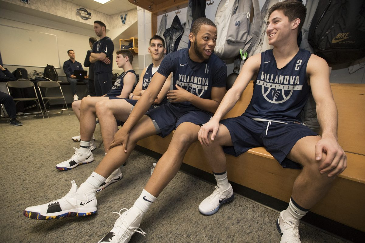 Omari Spellman, center, and Collin Gillespie of Villanova joke in the locker room before their practice session in TD Garden on March 22, 2018. They will face West Virginia in the round of 16 in the NCAA Tournament.