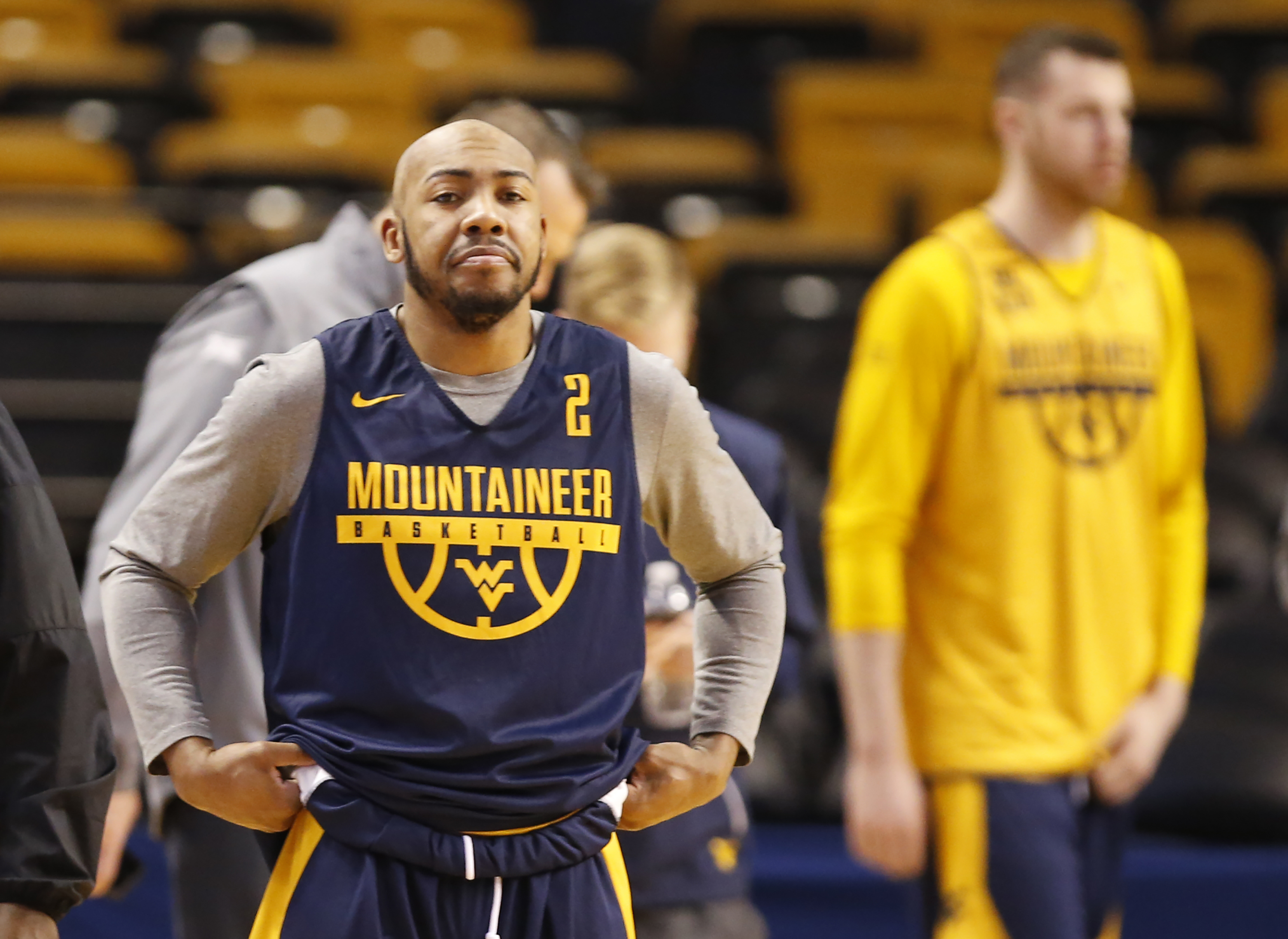Jevon Carter, left, and the West Virginia team warm-up during their practice session in TD Garden on March 22, 2018. They will face Villanova in the round of 16 in the NCAA Tournament. CHARLES FOX / Staff Photographer