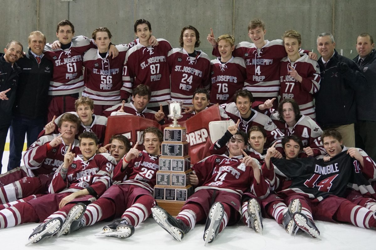 St. Joseph's Prep celebrates beating Holy Ghost Prep for its first Flyers Cup championship.