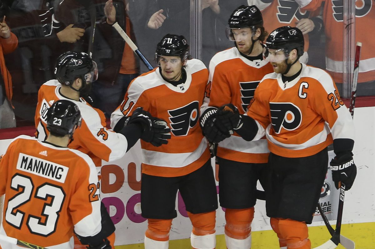 Travis Konecny, center, celebrates with his Flyers teammate after his second goal of the game against Rangers on Thursday.