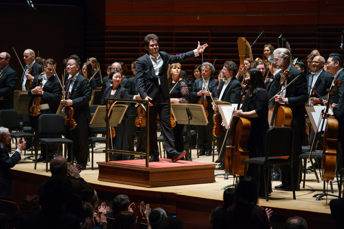 Lahav Shani and the Philadelphia Orchestra at the end of Thursday's concert at the Kimmel Center.