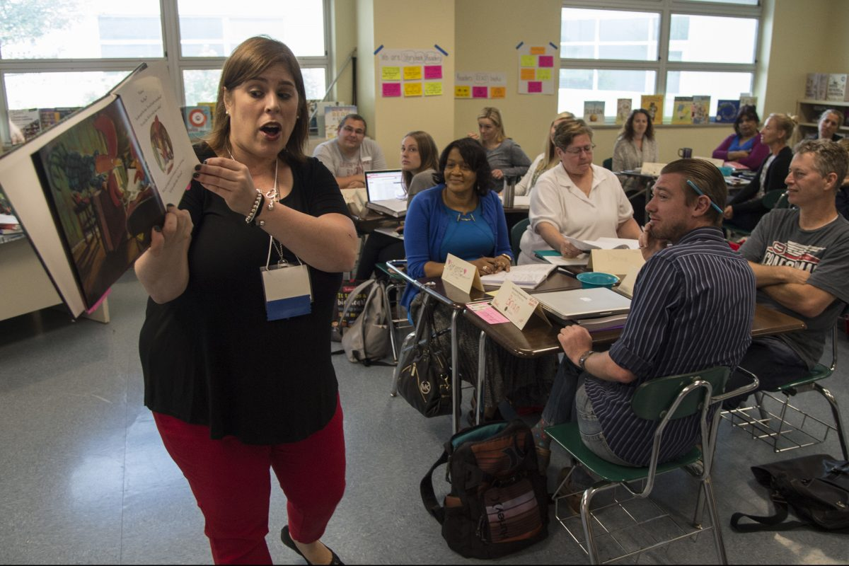 Stacy Dougherty, a kindergarten teacher at Clara Barton ES, leads a class of fellow elementary school teachers in how to Read Aloud and Shared Reading During the Literacy Block  during a Philadelphia School District training program for K-3 teachers on early literacy instruction.