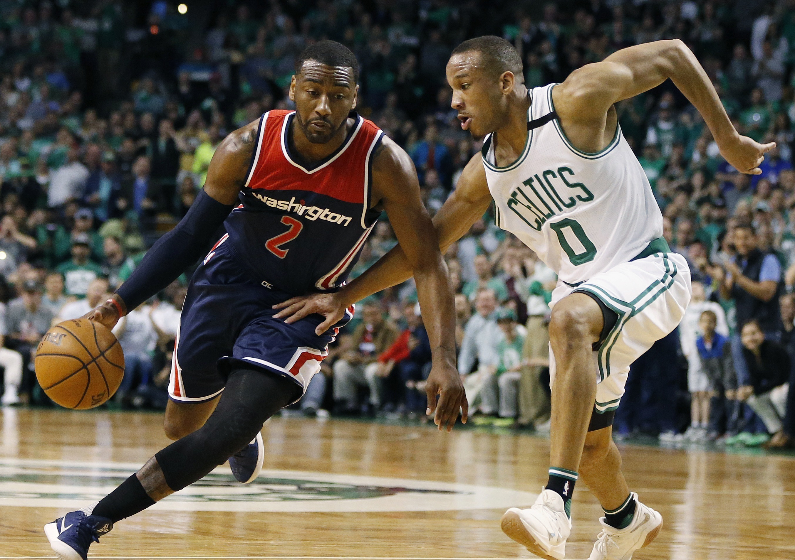 John Wall (2) drives past Boston Celtics guard  Avery Bradley (0) during a second-round playoff game in April.  (MICHAEL DWYER / AP)