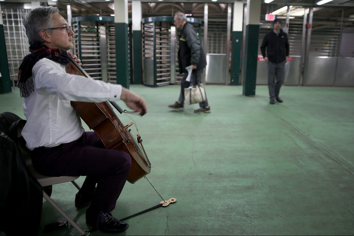 John Koen, a Philadelphia Orchestra cellist, plays at SEPTA's Walnut-Locust subway station on March 23, 2018 as part of Bach in the Subways.