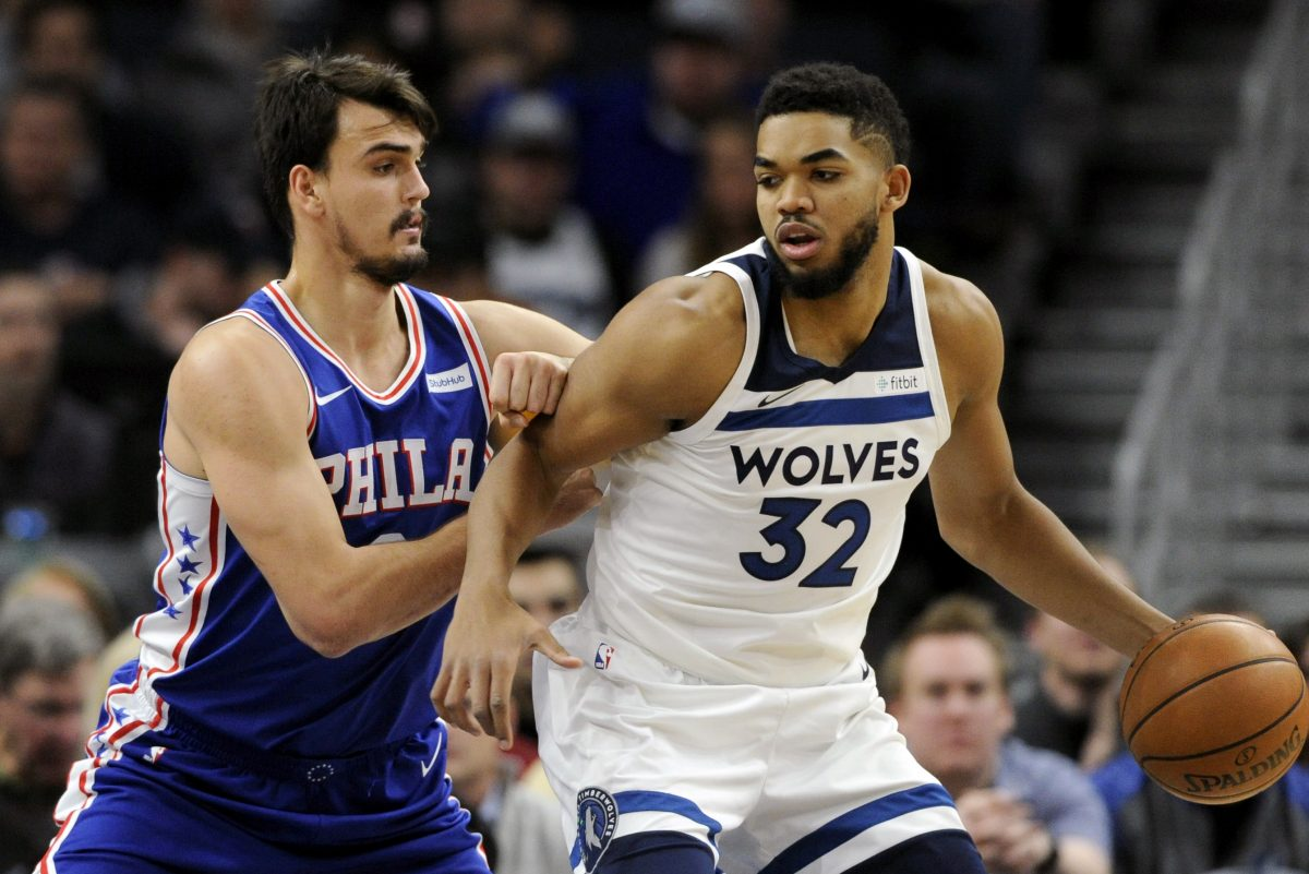 Sixers forward Dario Saric defends T-Wolves big man Karl-Anthony Towns during the team's first matchup this season on Dec. 12.