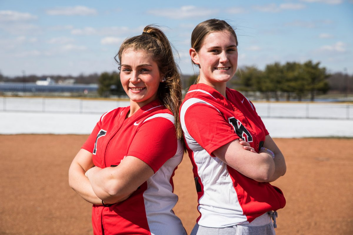 Danielle Dominik (left) and Grace Fagan are softball teammates and friends at Kingsway.