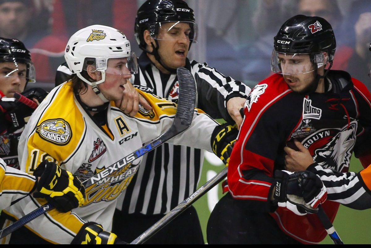 Brandon Wheat Kings' Nolan Patrick, left, and Rouyn-Noranda Huskies' Anthony-John Greer are separated as they scuffle during third period CHL Memorial Cup hockey action in Red Deer, Saturday, May 21, 2016.