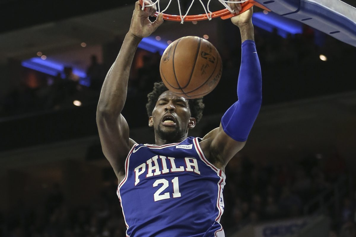 Sixers´ Joel Embiid slam dunks against the Pacers during the 4th quarter at the Wells Fargo Center in Philadelphia, Tuesday, March 13, 2018.