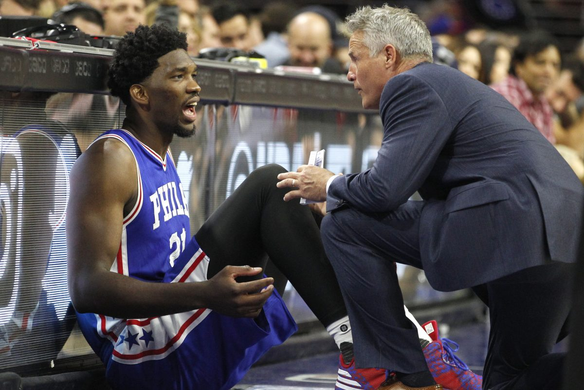 Sixers' coach Brett Brown (right) has seen the Sixers through the dark days and out the other side.