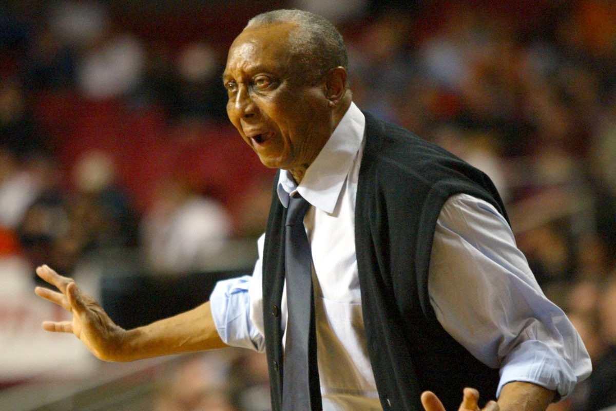 Temple Head Coach John Chaney yells to his team in the first half against Princeton, Monday, 12/20/2004. Temple beat Princeton 48-46. Chaney coached his 1000th game.