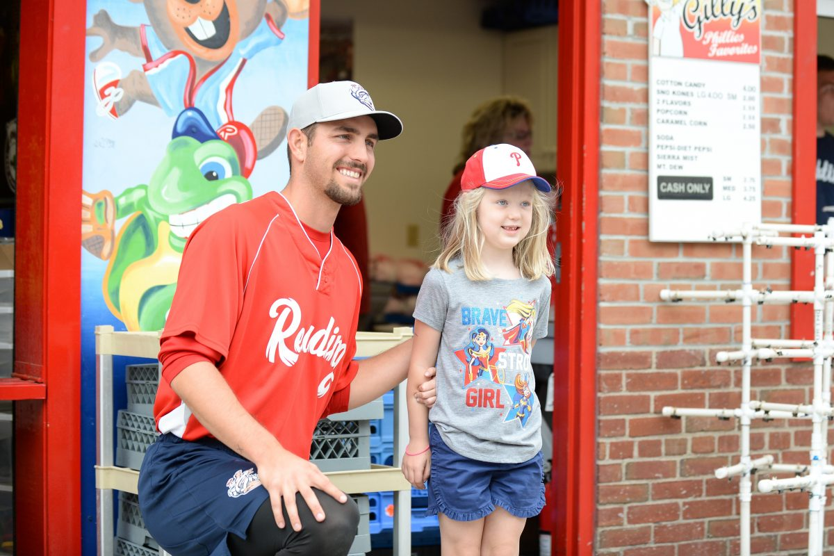 Phillies pitcher Austin Davis poses with a fan. Austin Sullivan/Reading Fightin Phils