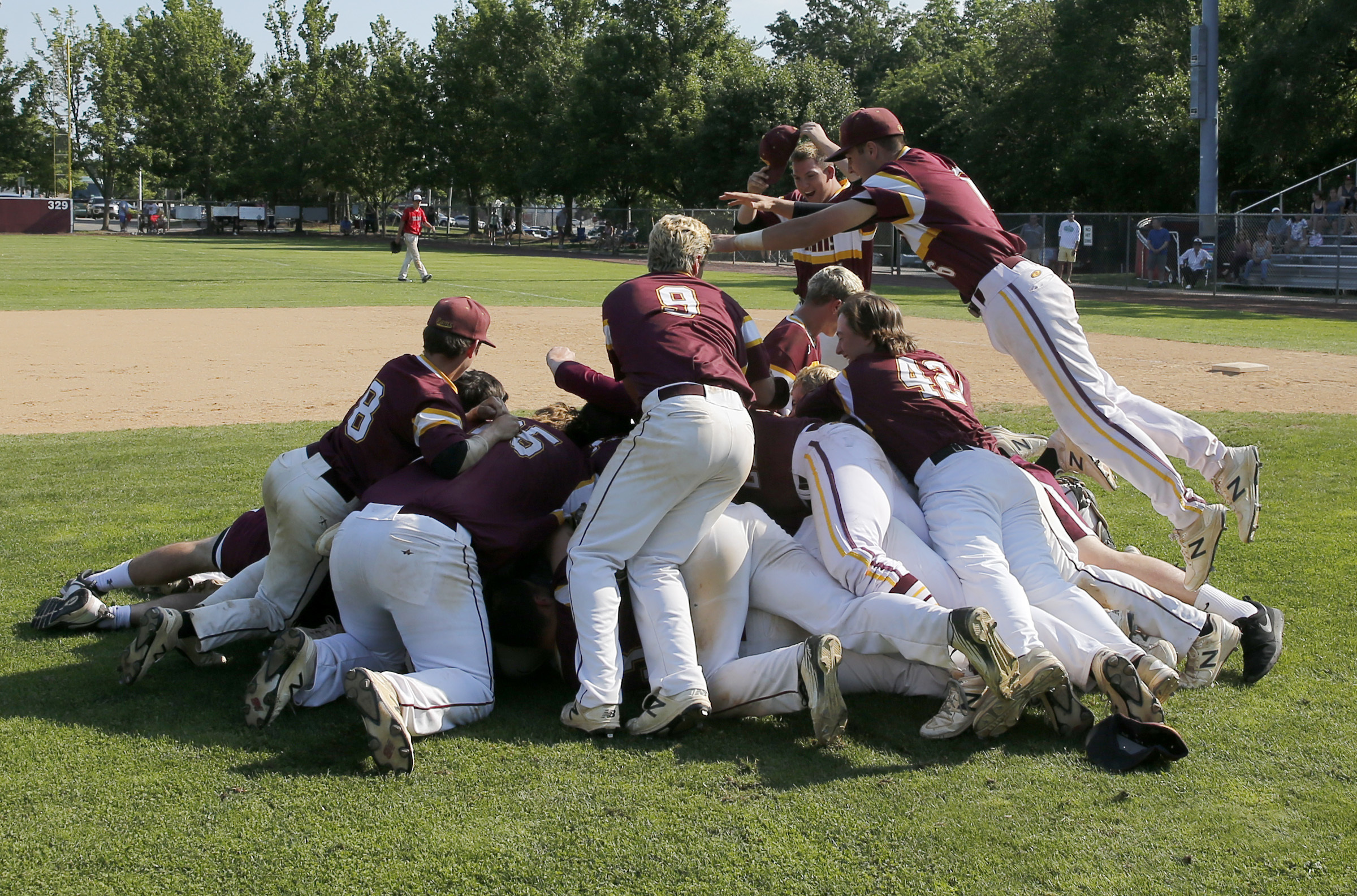 Gloucester Catholic High baseball players celebrate after beating Newark Academy 15-5 for the New Jersey High School Non-Public B state title baseball title at Toms River South High School on Saturday, June 10, 2017.