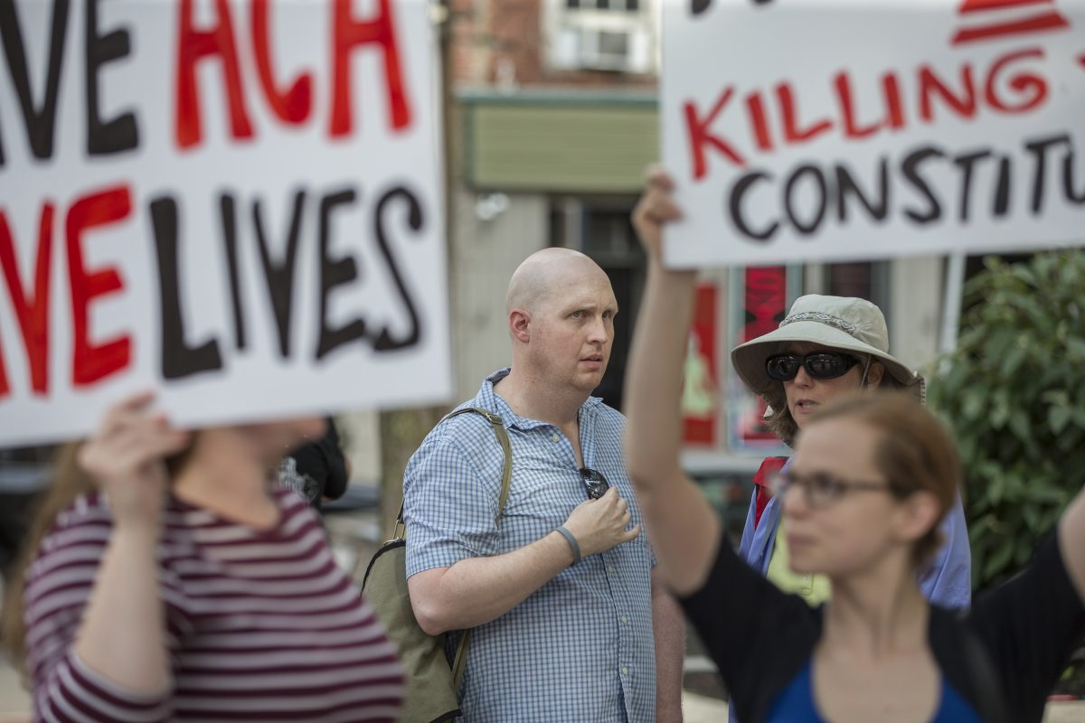 Brian Kline of Quakertown planned to hold the vigil outside Sen. Pat Toomey's Philadelphia office for the entire 24-hour period. Kline said he earns just over $11 an hour working part-time. He was diagnosed with colon cancer last year.  MICHAEL BRYANT / Staff Photographer