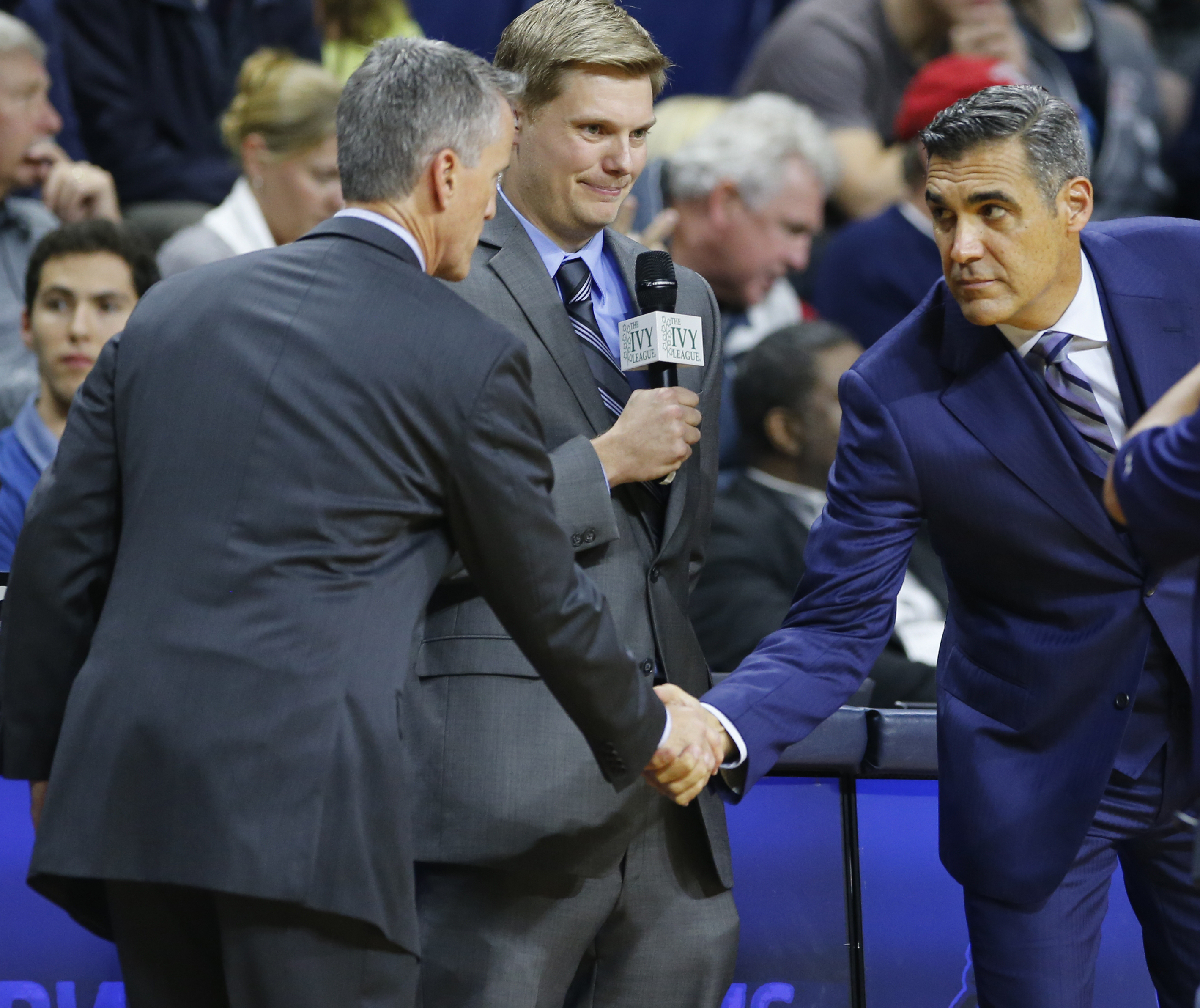 Head Coaches Steve Donahue (left) of Penn and Jay Wright (right) of Villanova shake hands before a game from last season.