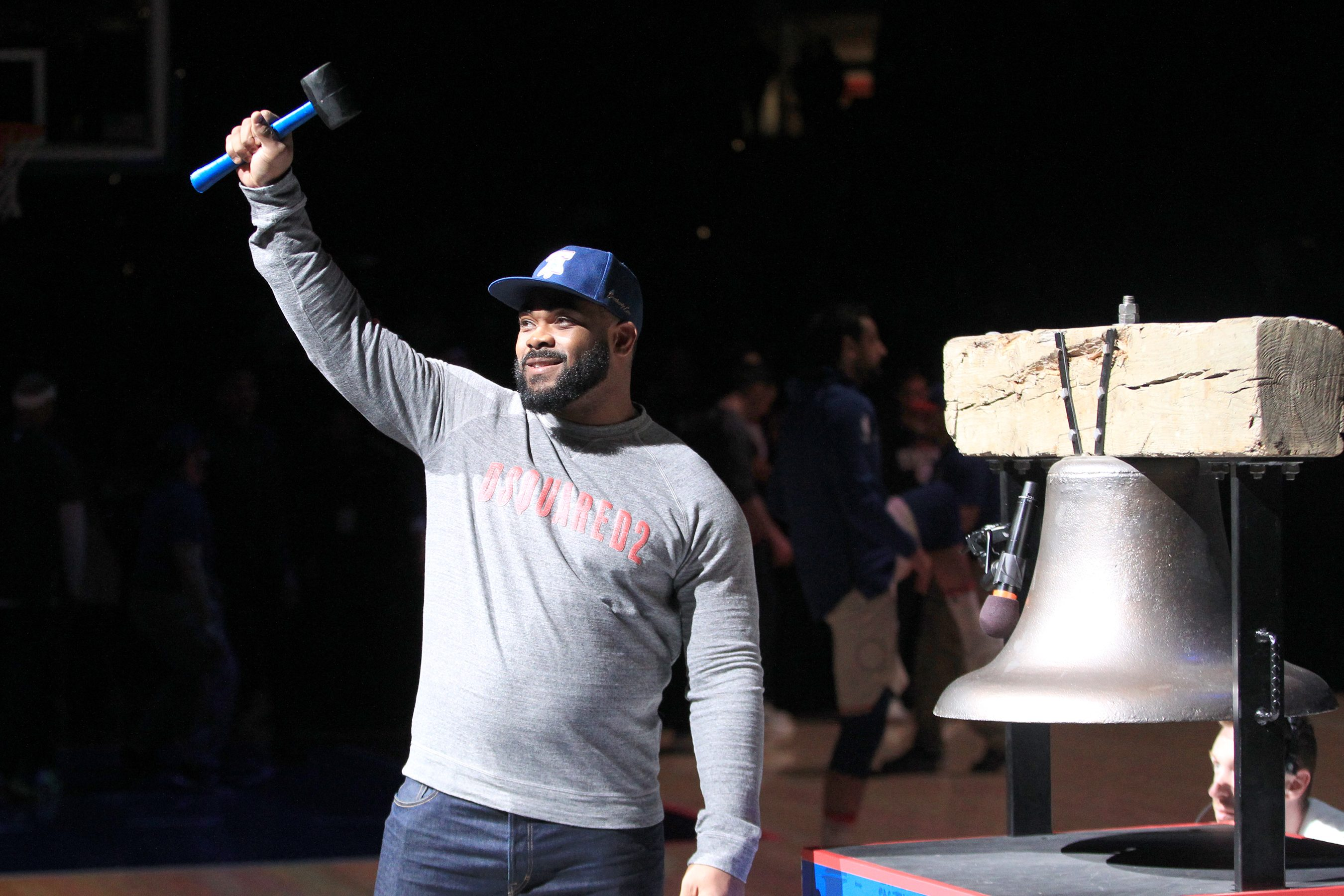 Brandon Graham of the Eagles rang the Liberty Bell replica before the Sixers and Hornets game at the Wells Fargo Center on March 2, 2018.