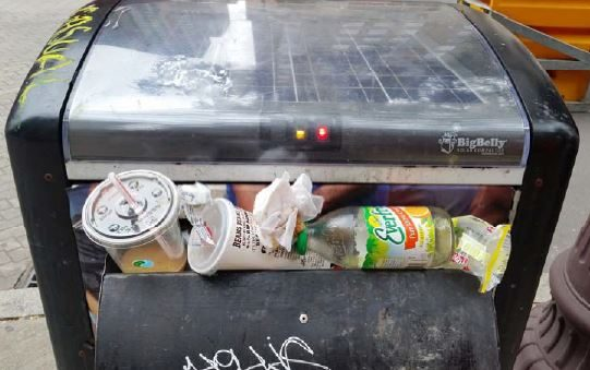 A Big Belly trash compactor.