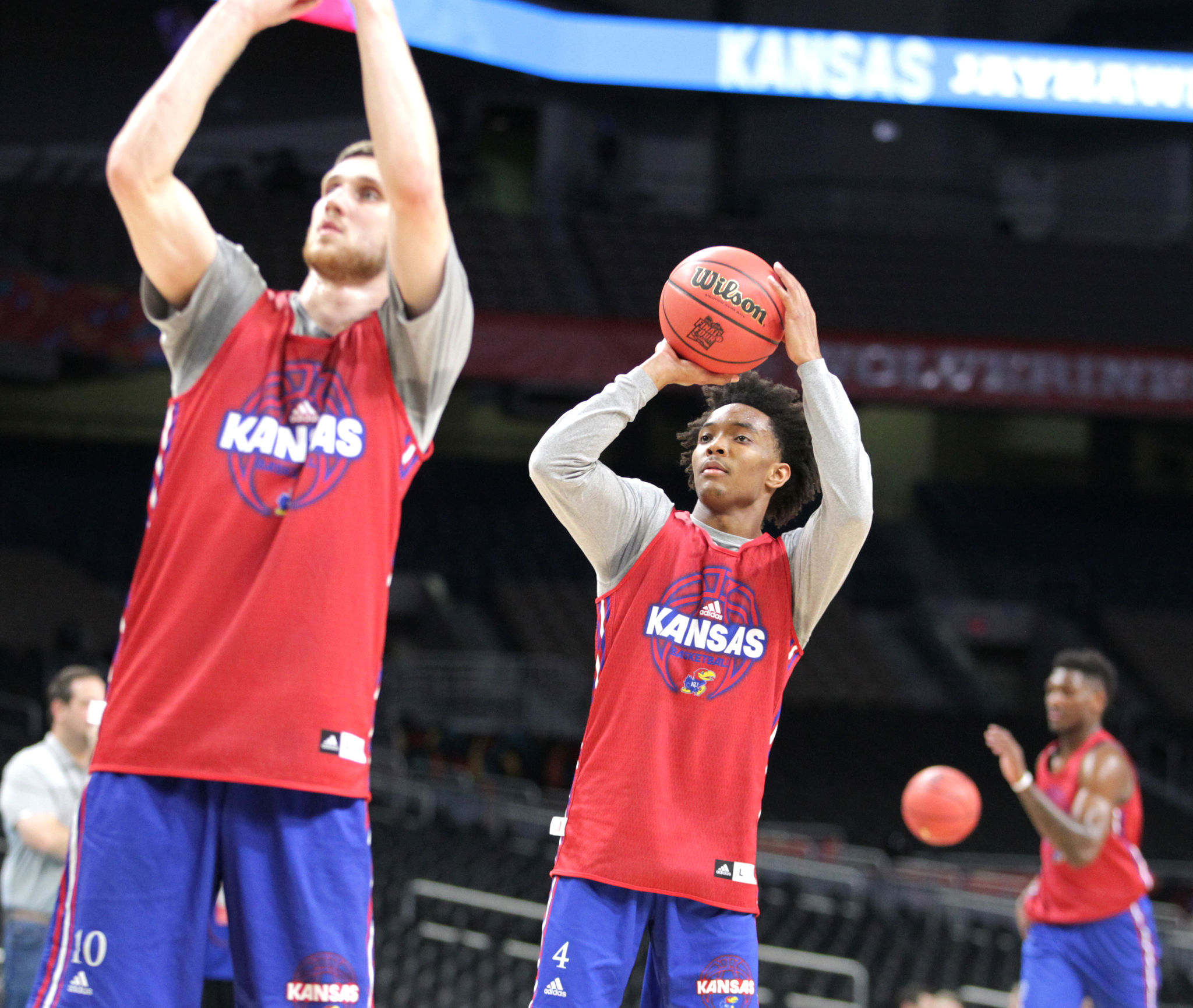 Svlatoslav Mykhailiuk, left, and DevonteÕ Graham, center of Kansas shoot during practice sessions for the Final Four of the NCAA Tournament at San Antonio on March 30, 2018.