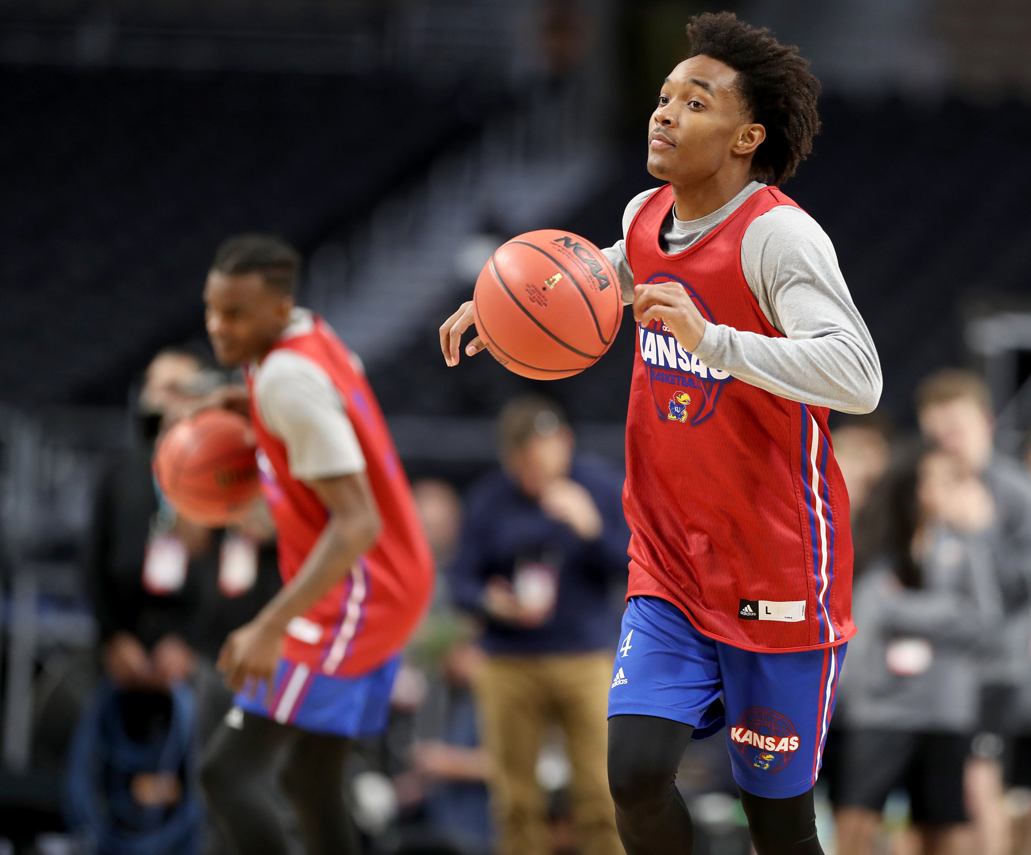 DevonteÕ Graham, right, of Kansas dribbles up court during practice sessions for the Final Four of the NCAA Tournament at San Antonio on March 30, 2018.