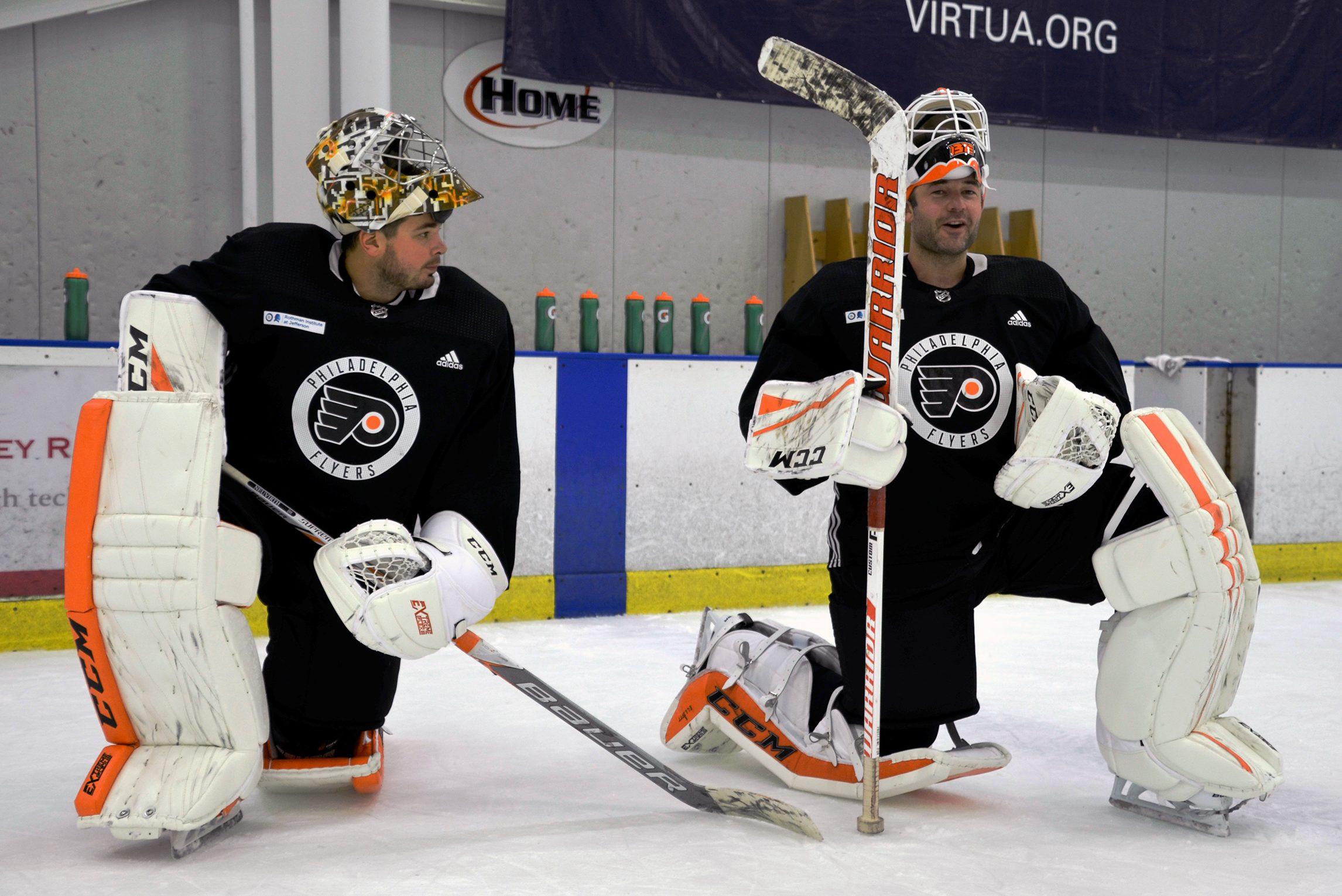 Flyers goalies Michal Neuvirth (left) and Brian Elliott.