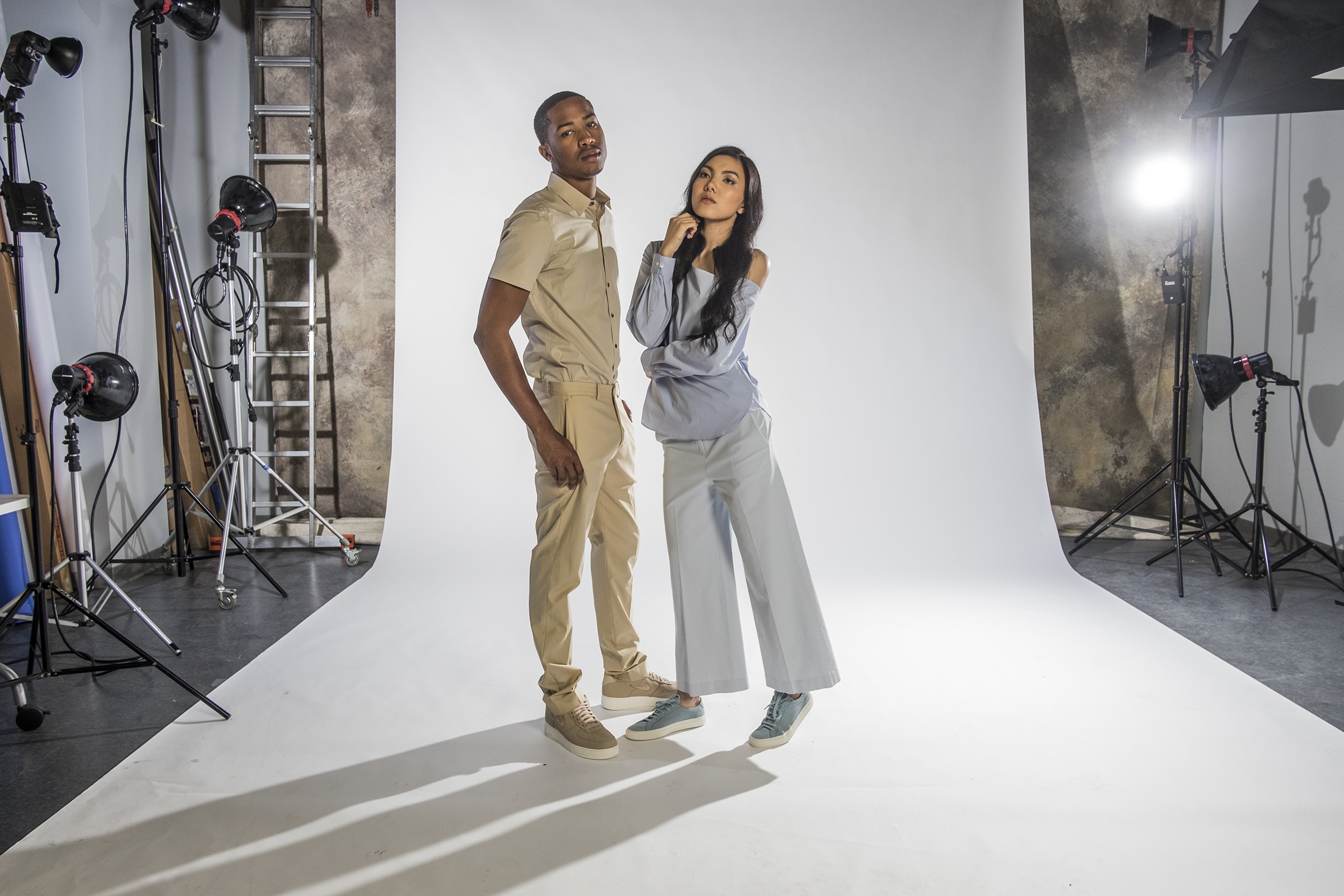 Here  Donovan wears a short-sleeved button-down shirt in khaki, Sylvain, $175; flat-front pant in Khami, Jake W, $245, both at Theory.The sneakers: Khaki Nike Air Force One, $150, at Ubiq. Mely Duong. pulls off this blue off-the-shoulder blouse, Ulrika, $235; Capri pant in sky blue, Nadeema, $235, at Theory.The sneakers: Sky blue sneakers, Woman by Common Projects, $449, at Theory. ED HILLE / Staff Photographer