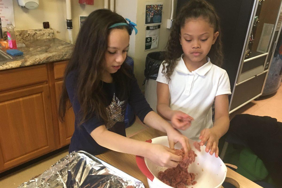 Star Marie Rodriguez (left) and Janaiyah English make meatballs for Italian Wedding Soup.
