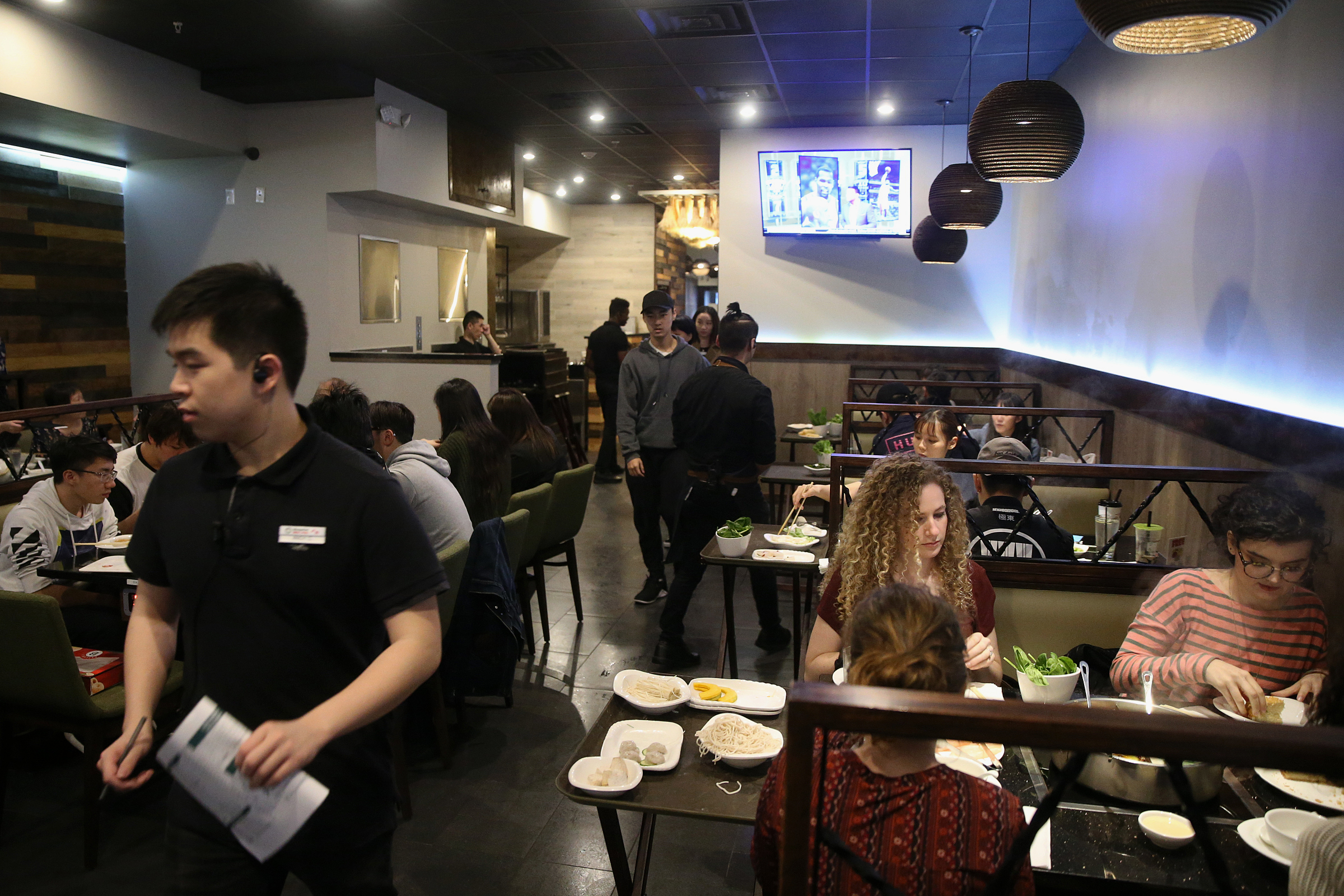 Customers fill the dining room during dinnertime at Little Sheep Mongolian Hot Pot in Chinatown.