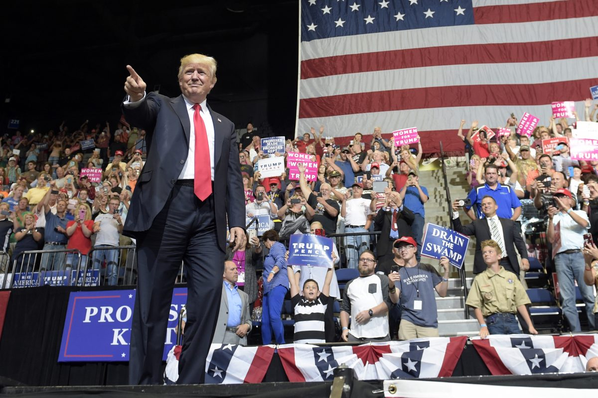 President Donald Trump arrives on stage to speak at the U.S. Cellular Center in Cedar Rapids, Iowa, on Wednesday.