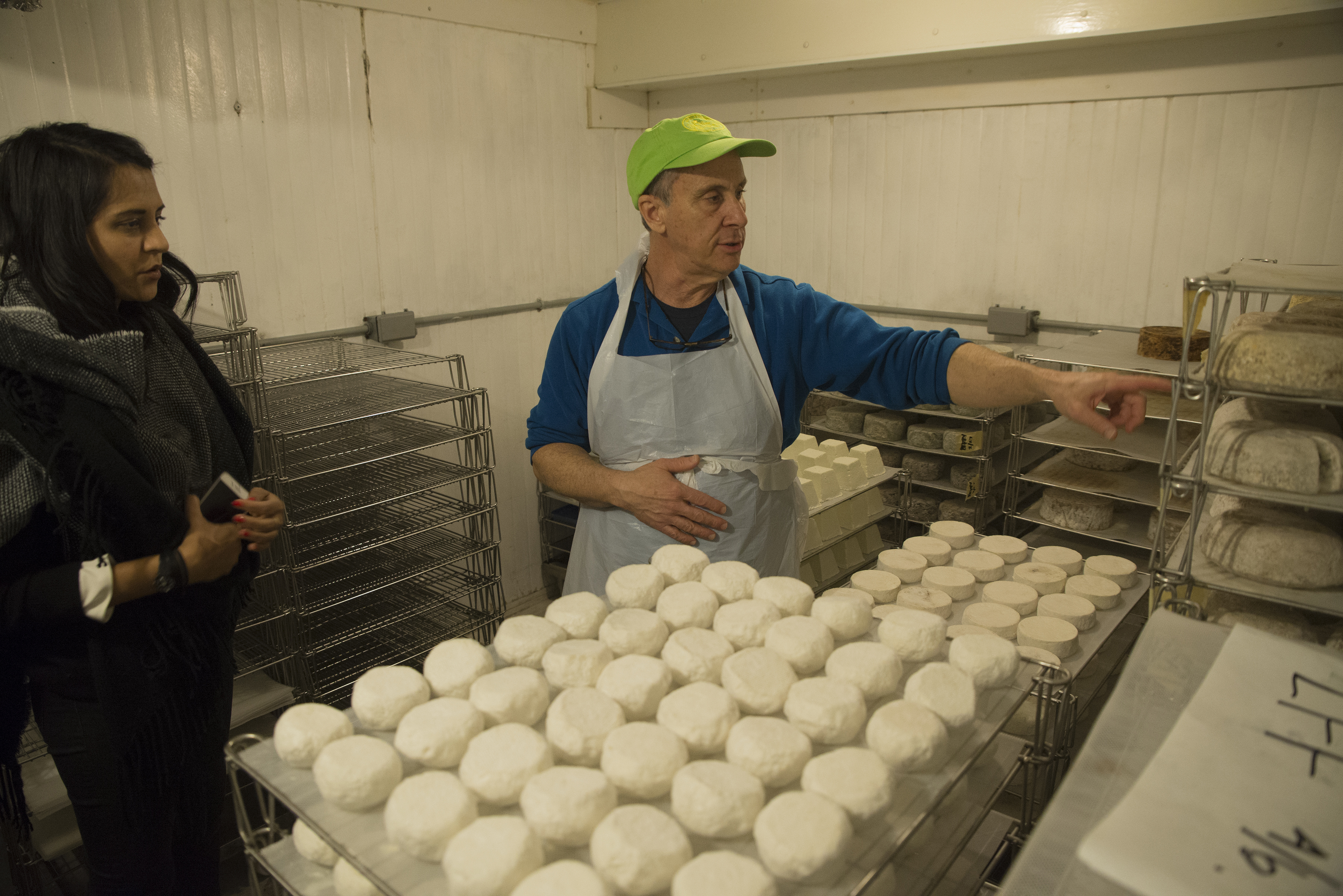 Kavita Patel , forager for Whole Foods checks the goat cheese production with Al Renzi , owner of Yellow Springs Farm in Chester Springs, Pa.