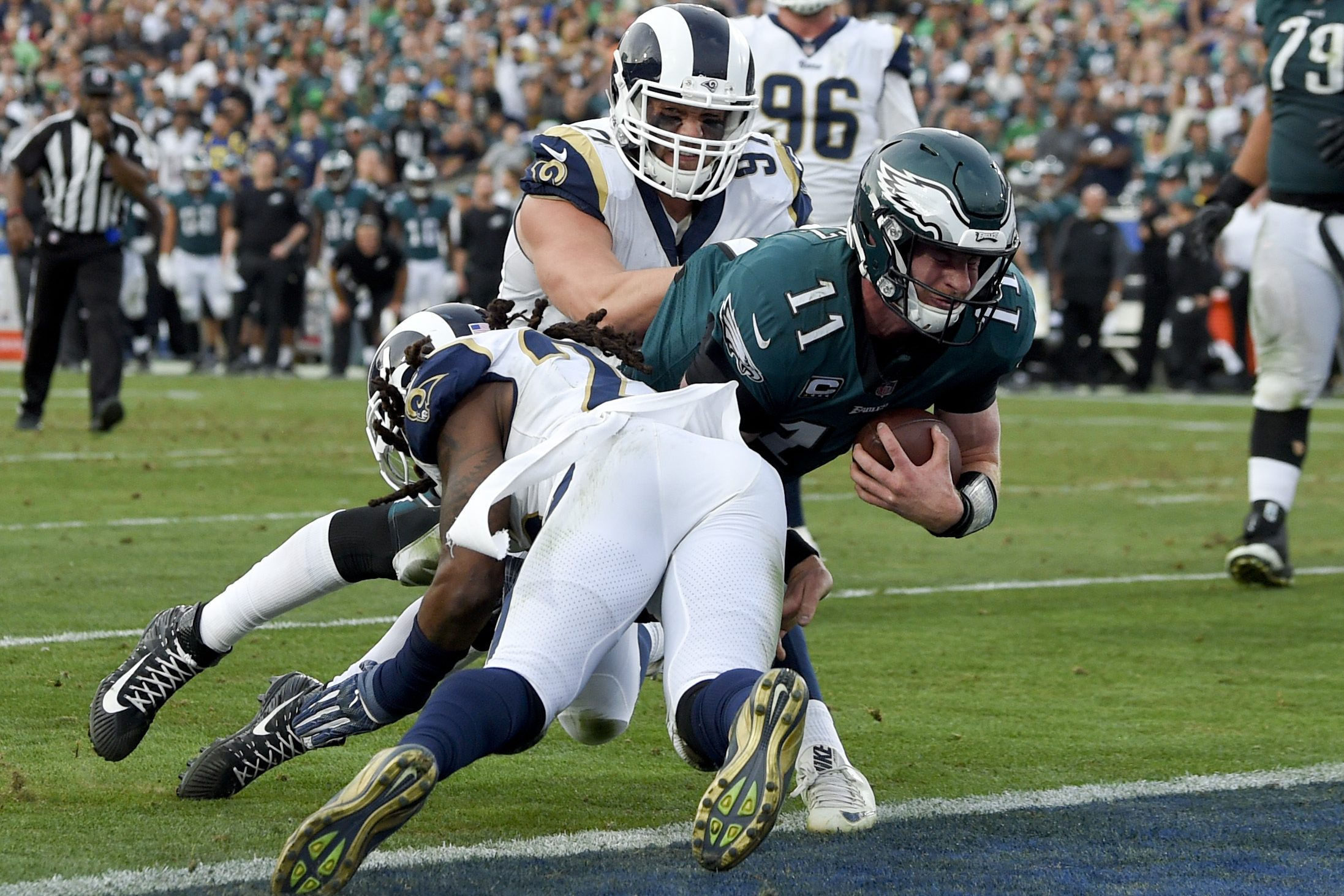 Eagles quarterback Carson Wentz dives for the goal line against the Rams last December. Wentz injured his knee on the play.