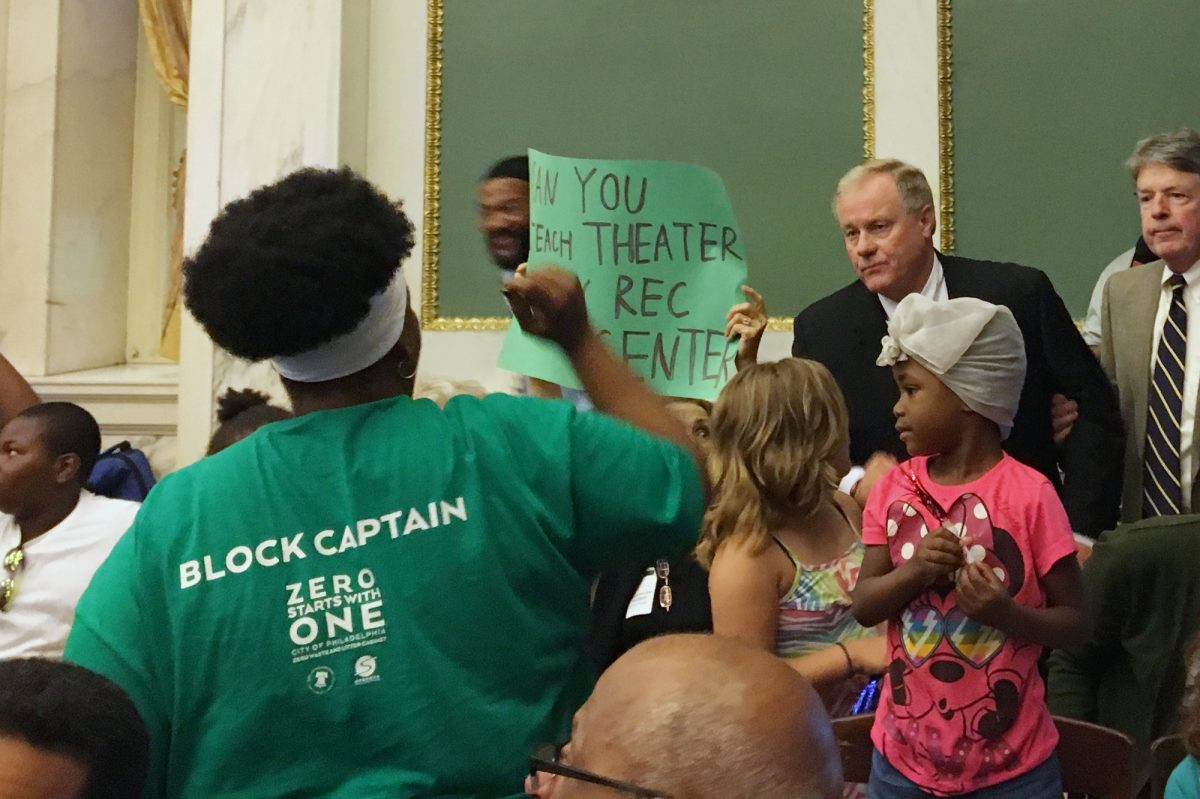 State Sen. Scott Wagner speaks with protesters disrupting his Local Government Committee hearing in City Hall.