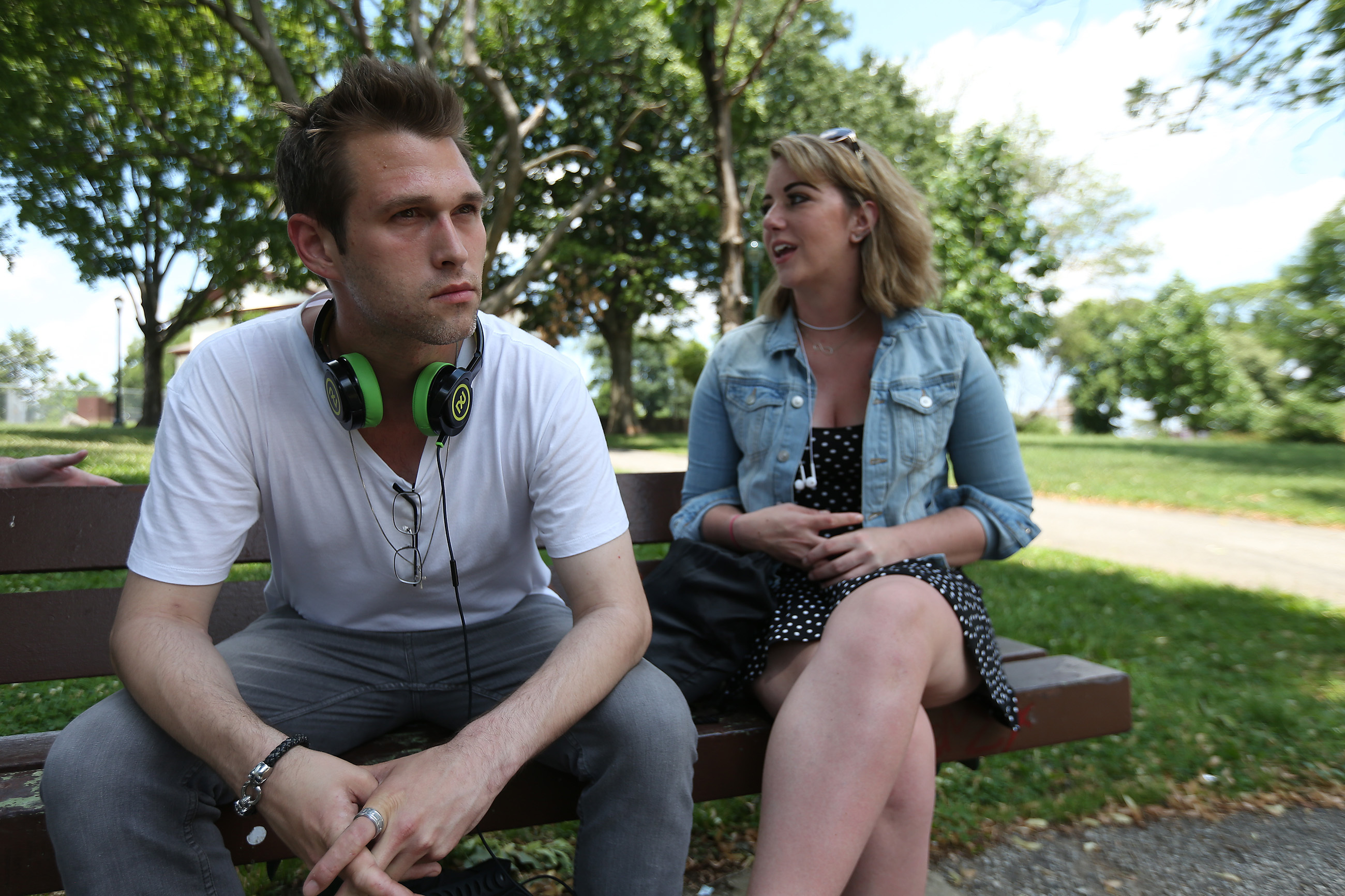 Ryan Sipler and Angela Caruso, sitting on a bench in McPherson Square, wound up in Philly chasing heroin and are now in treatment.
